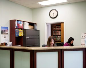 "Front Desk of the Chiropractic Center ""Prestige Health & Wellness"" in the Bayside"